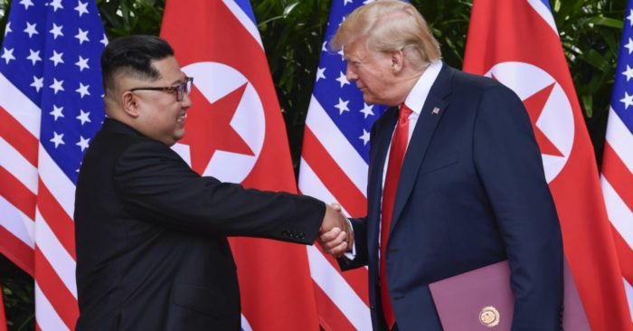 North Korea leader Kim Jong Un and U.S. President Donald Trump shake hands at the conclusion of their meetings at the Capella resort on Sentosa Island in Singapore.