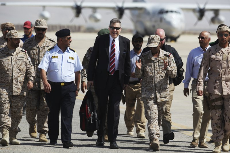"Matthew Tueller, the U.S. ambassador to Yemen, arrives at an air base for a military ceremony in Mukalla, Yemen, Thursday, Nov. 29, 2018.  Tueller accused Iran of ""throwing gasoline on the fire"" of conflicts across the Middle East, vowing that America will defend its regional interests and not ""shy away when the problems get difficult."" (AP Photo/Jon Gambrell)"