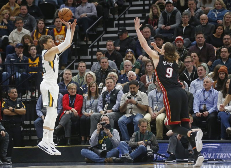 Utah Jazz guard Kyle Korver (26) shoots as Miami Heat forward Kelly Olynyk (9) defends in the first half during an NBA basketball game Wednesday Dec. (AP Photo/Rick Bowmer)