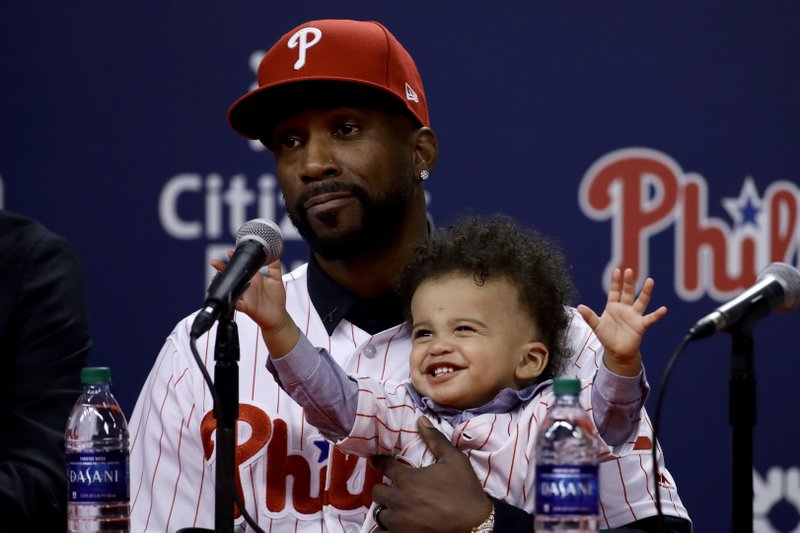 Philadelphia Phillies new outfielder Andrew McCutchen accompanied by his son Steel speaks during a news conference in Philadelphia, Tuesday, Dec. (AP Photo/Matt Rourke)