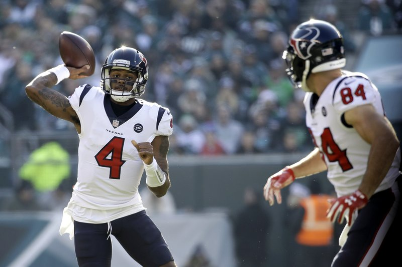 Houston Texans' Deshaun Watson (4) passes as Ryan Griffin (84) looks on during the first half of an NFL football game against the Philadelphia Eagles, Sunday, Dec. (AP Photo/Matt Rourke)