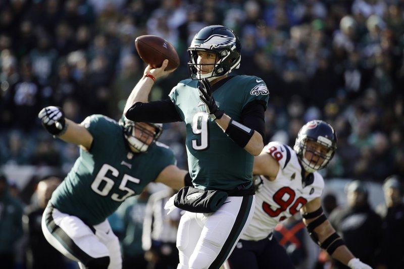 Philadelphia Eagles' Nick Foles passes during the first half of an NFL football game against the Houston Texans, Sunday, Dec. (AP Photo/Matt Rourke)