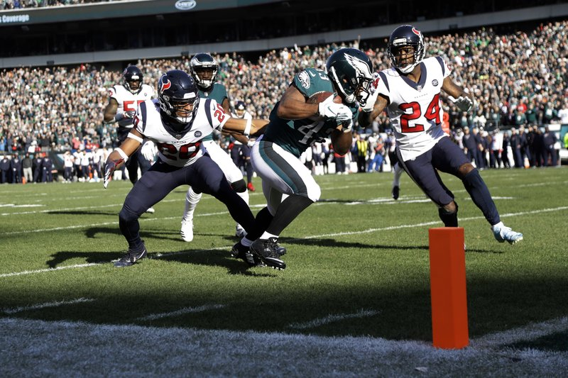 Philadelphia Eagles' Darren Sproles (43) scores a touchdown against Houston Texans' Justin Reid (20) and Johnathan Joseph (24) during the first half of an NFL football game, Sunday, Dec. (AP Photo/Michael Perez)