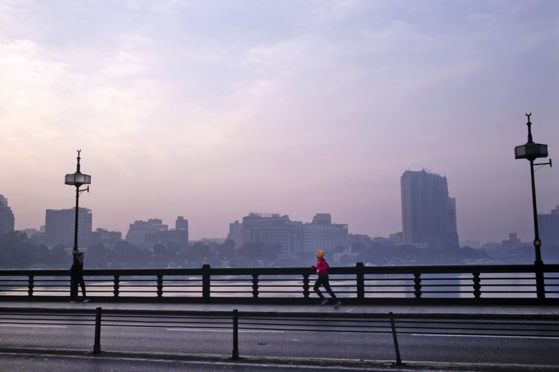 In this Jan. 22, 2017 file photo, a man jogs on Kasr El Nil bridge as the sun begins to rise, in Cairo, Egypt. (AP Photo/Nariman El-Mofty, File)