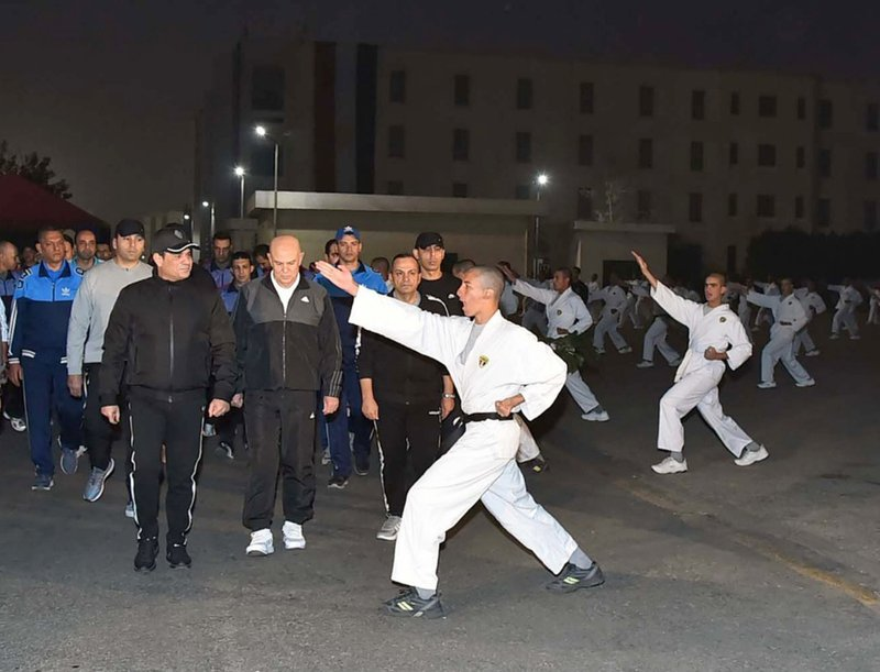 In this Dec. 16, 2018 photo released by the Egyptian Presidency, Egyptian President Abdel-Fattah el-Sissi inspects cadets during their morning exercises at the national Military Academy, in a suburb of Cairo, Egypt. (Egyptian Presidency via AP)