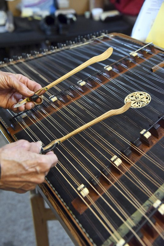 In this Nov. 28, 2018, hammered dulcimer master Maggie Sansone plays her instrument in Shady Side, Md. (Paul W. Gillespie/Capital Gazette via AP)