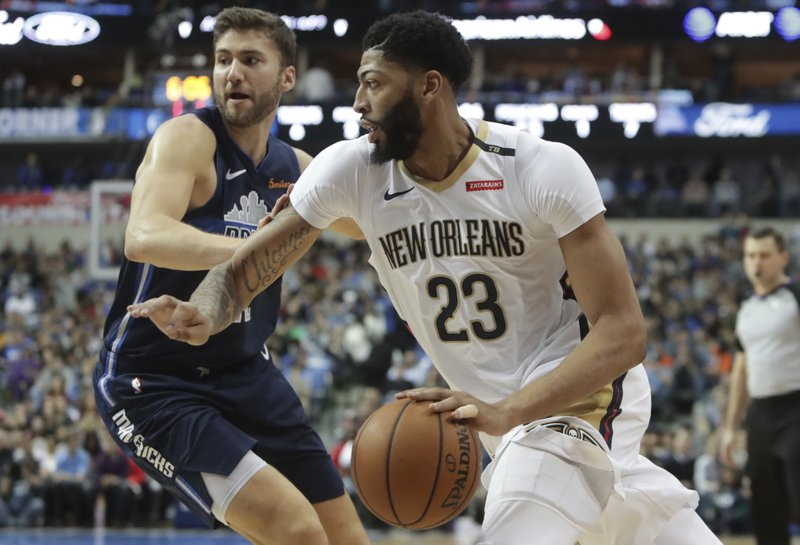 New Orleans Pelicans forward Anthony Davis (23) drives past Dallas Mavericks forward Maximilian Kleber during the first half of an NBA basketball game in Dallas, Wednesday, Dec. (AP Photo/LM Otero)