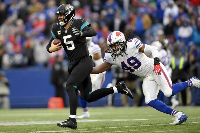File-This Nov. 25, 2018, file photo shows Buffalo Bills middle linebacker Tremaine Edmunds (49) moving in to tackle Jacksonville Jaguars quarterback Blake Bortles (5) during the second half of an NFL football game, in Orchard Park, N. (AP Photo/Adrian Kraus, File)