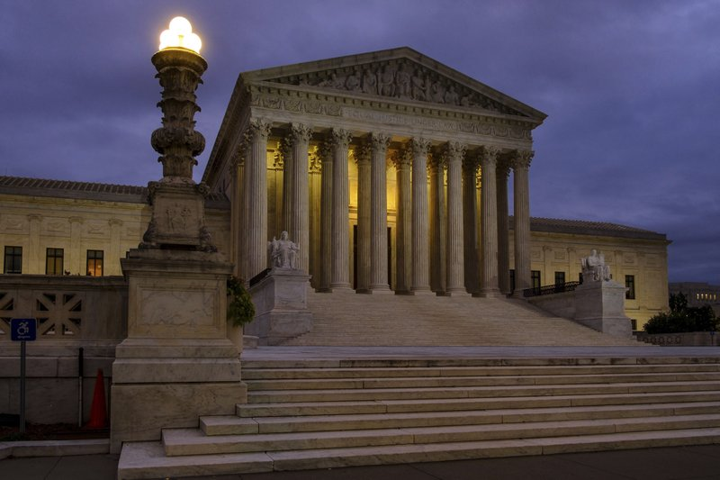 FILE - This Oct. 5, 2018, file photo shows the U. S. Supreme Court building before dawn in Washington. (AP Photo/J. David Ake, File)