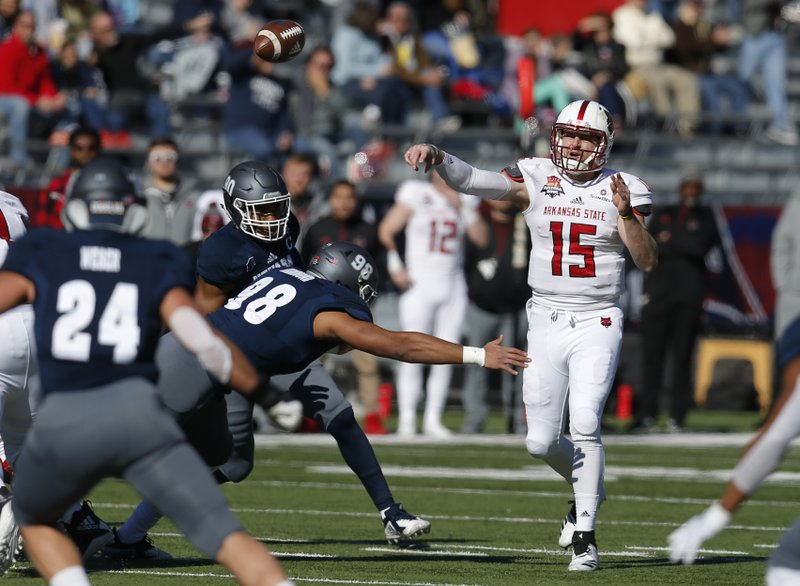 Arkansas State quarterback Justice Hansen (15) throws down field in the first half during an NCAA college football bowl game against Nevada, Saturday, Dec. (AP Photo/Rick Scuteri)