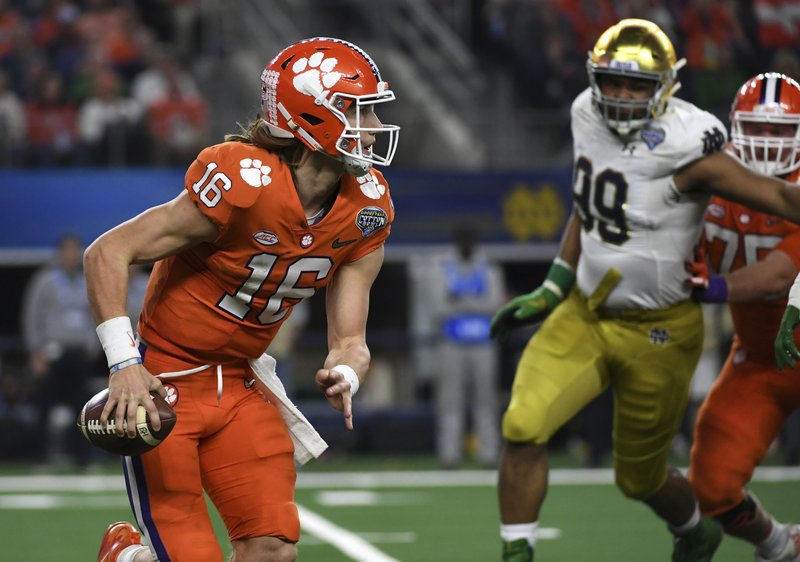 Clemson quarterback Trevor Lawrence (16) is pressured out of the pocket in the second half of the NCAA Cotton Bowl semi-final playoff football game against Notre Dame on Saturday, Dec. (AP Photo/Jeffrey McWhorter)