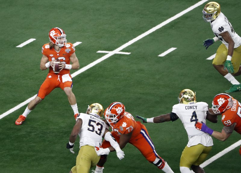 Clemson quarterback Trevor Lawrence (16) prepares to throw fro the pocket in the first half of the NCAA Cotton Bowl semi-final playoff football game against Notre Dame on Saturday, Dec. (AP Photo/Roger Steinman)
