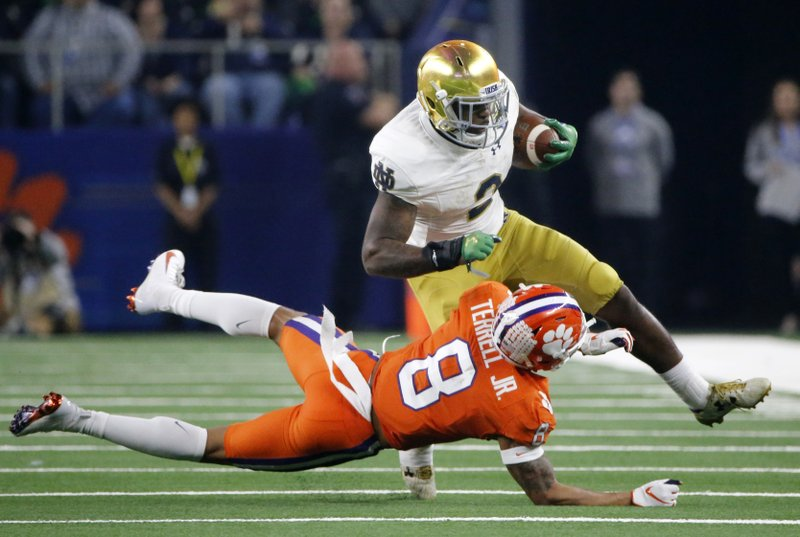 Clemson cornerback A.J. Terrell (8) attempts to stop Notre Dame running back Dexter Williams (2) after a short run in the second half of the NCAA Cotton Bowl semi-final playoff football game, Saturday, Dec. (AP Photo/Michael Ainsworth)
