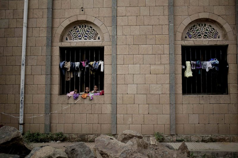 Children look out of their room at a shelter for displaced persons in Ibb, Yemen, in this Aug. 3, 2018, photo. (AP Photo/Nariman El-Mofty)