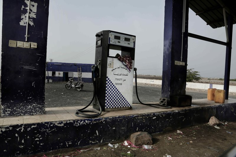 This July 24, 2018, photo shows a gas station on a road in Shabwah, Yemen. The civil war has pushed Yemen into economic collapse, with major fuel shortages along with inflation that has left many unable to afford food. (AP Photo/Nariman El-Mofty)
