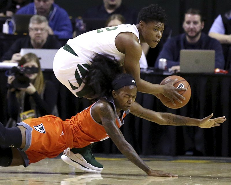 Baylor guard Moon Ursin (12) grabs the loose ball from University of Texas Rio Grande Valley guard Jameka Dowell (5) in the first half of an NCAA college basketball game, Monday Dec. (Jerry Larson/Waco Tribune-Herald via AP)