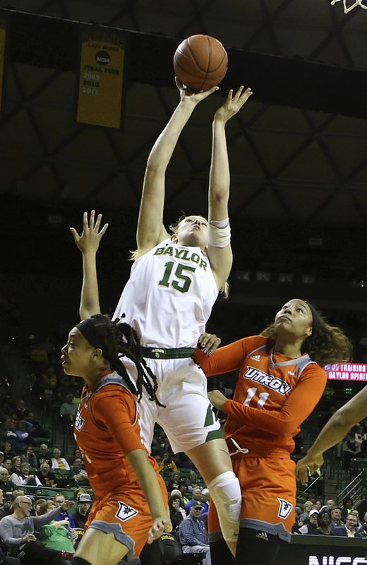Baylor forward Lauren Cox (15) shoots between University of Texas Rio Grande Valley guard Nichele Hyman (15), left, and University of Texas Rio Grande Valley guard Quynne Huggins (11), right, in the first half of an NCAA college basketball game, Monday Dec. (Jerry Larson/Waco Tribune-Herald via AP)