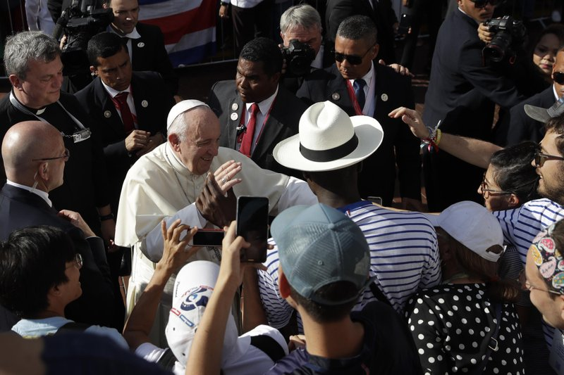 Pope Francis blesses a group of pilgrims as he arrives to celebrate Mass at the Santa Maria La Antigua cathedral on the occasion of his visit for World Youth Day, in Panama City, Saturday, Jan. (AP Photo/Alessandra Tarantino)
