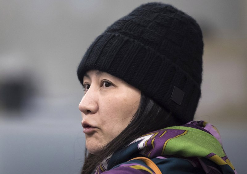 FILE - In this Dec. 12, 2018, file photo, Huawei chief financial officer Meng Wanzhou arrives at a parole office in Vancouver, British Columbia. (Darryl Dyck/The Canadian Press via AP, File)
