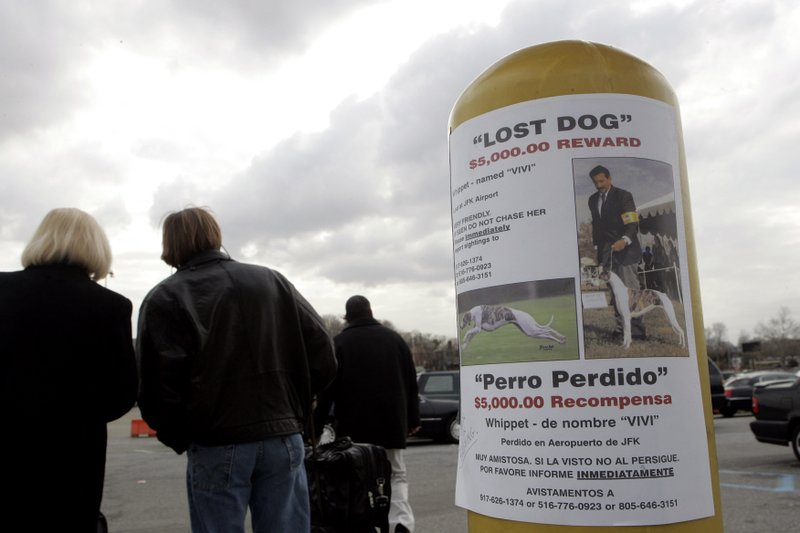 FILE - In this March 24, 2006, file photo, a reward is posted near a parking lot at LaGuardia airport in New York, after Vivi, a show dog, bolted from her carrier at the airport following the Westminster Kennel Club show. (AP Photo/Frank Franklin II, File)