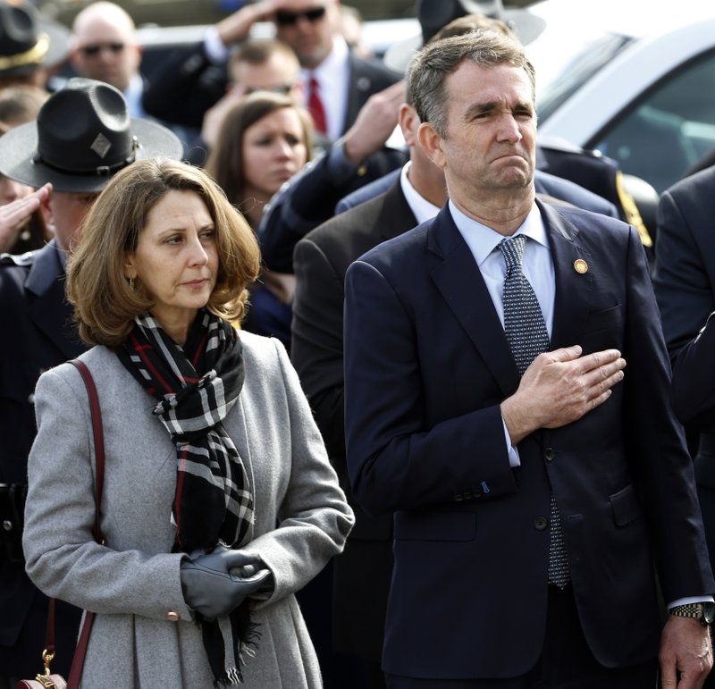 Virginia Gov. Ralph Northam, right, and his wife Pam, watch as the casket of fallen Virginia State Trooper Lucas B. (AP Photo/Steve Helber, Pool)