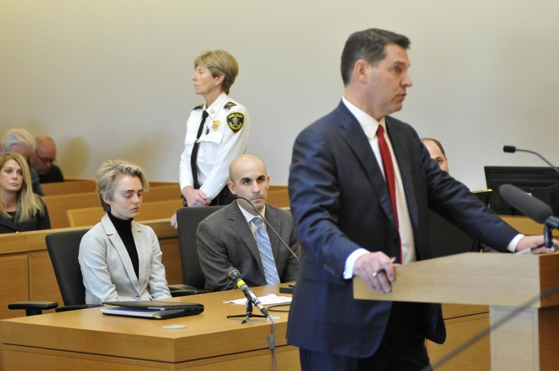 Michelle Carter, 22, second left, appears in Taunton District Court in Taunton, Mass. Monday, February 11, 2019 for a hearing on her prison sentence as lawyer Joe Cataldo speaks at the podium. (Mark Stockwell/The Sun Chronicle via AP, Pool)