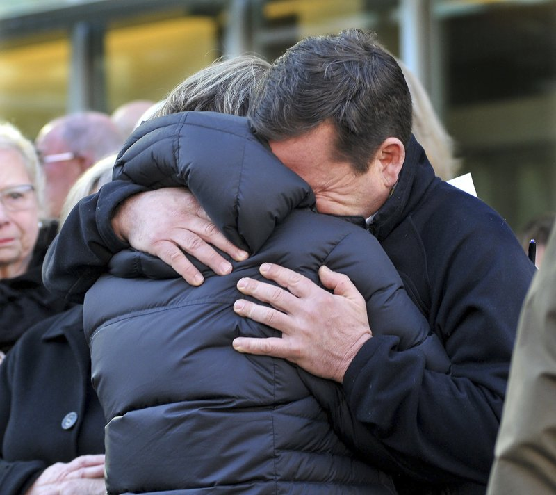 Conrad Roy, Jr., right, father of texting suicide victim Conrad Roy III, and Conrad III's aunt Becky Maki hug after a hearing Monday, February 11, 2019 where defendant Michelle Carter's 15 month prison term was upheld in Taunton District Court in Taunton, Mass. (AP POOL/Mark Stockwell)/The Sun Chronicle via AP)