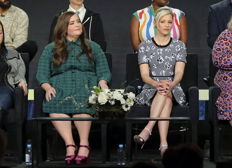 Aidy Bryant, left, and Elizabeth Banks participate in the