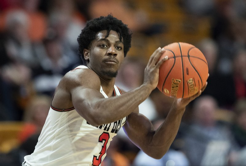 Campbell University guard Chris Clemons readies to pass the basketball against Presbyterian College in the second half of an NCAA basketball game Thursday, Jan. (AP Photo/Jason E. Miczek)