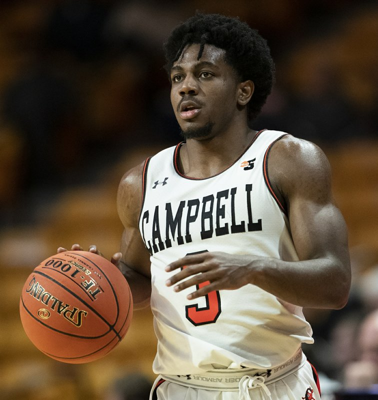 Campbell University guard Chris Clemons brings the ball up court against Presbyterian College in the second half of an NCAA basketball game Thursday, Jan. (AP Photo/Jason E. Miczek)
