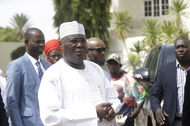 Nigerian presidential candidate, Atiku Abubakar, of the People's Democratic Party, speaks to journalists after the presidential election was delayed by the Independent National Electoral Commission, at his residence in Yola, Nigeria Saturday, Feb. (AP Photo/Sunday Alamba)