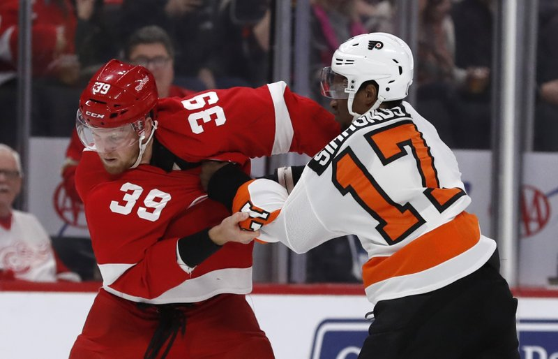 Detroit Red Wings right wing Anthony Mantha (39) and Philadelphia Flyers right wing Wayne Simmonds (17) fight during the first period of an NHL hockey game, Sunday, Feb. (AP Photo/Carlos Osorio)