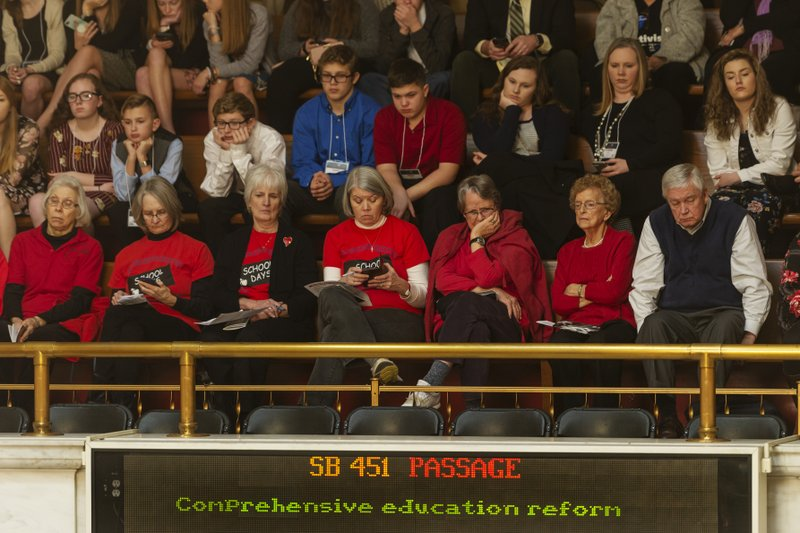The public viewing galleries are lined with visitors as delegates debate Senate Bill 451, commonly referred to as the omnibus education bill, in the House of Delegates chamber at the Capitol in Charleston, W. (Craig Hudson/The Charleston Gazette-Mail via AP)