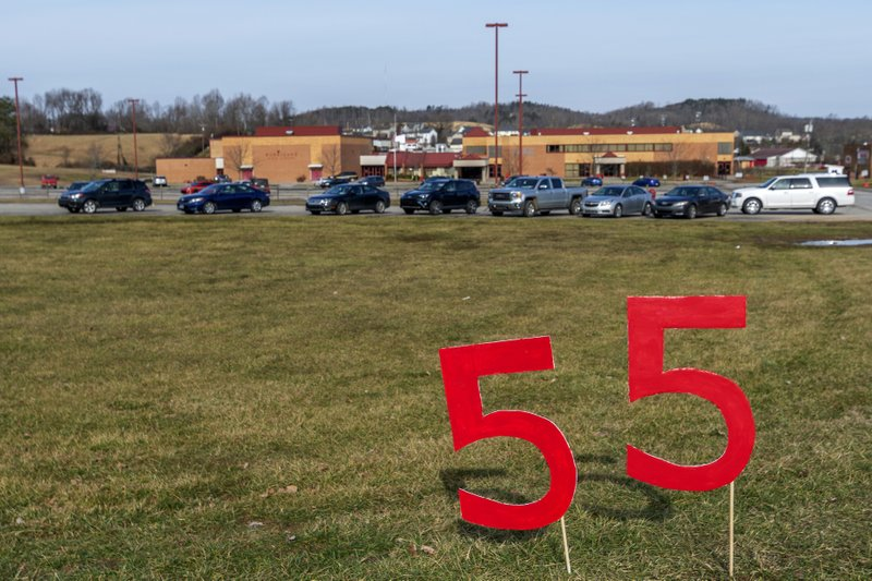 A 55 United sign stands outside of Hurricane High School which remains open in Putnam County, W.Va, during the first day of a statewide strike by teachers and school personnel on Tuesday, Feb. (Craig Hudson/Charleston Gazette-Mail via AP)