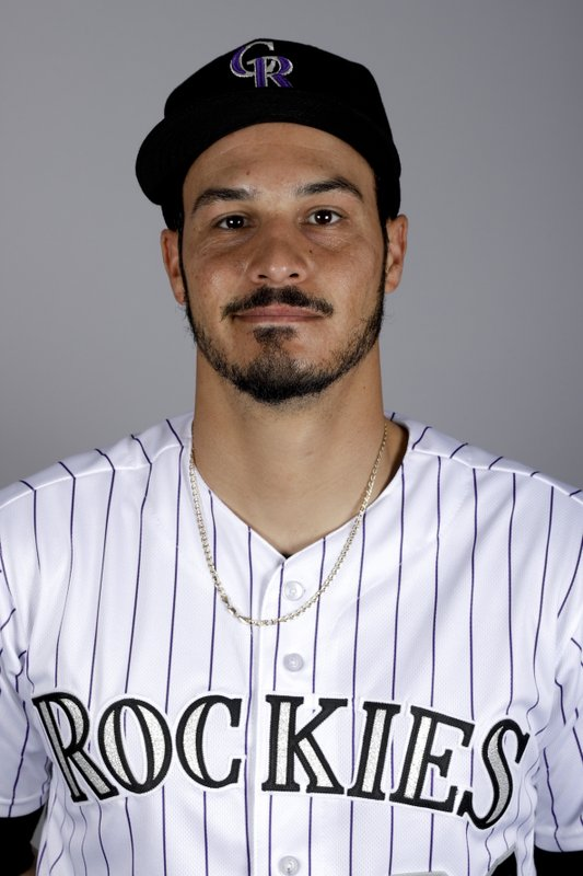 File-This is a 2019 photo of Nolan Arenado of the Colorado Rockies. Arenado likes where he's at and the direction the Colorado Rockies are headed. (AP Photo/Chris Carlson, File)