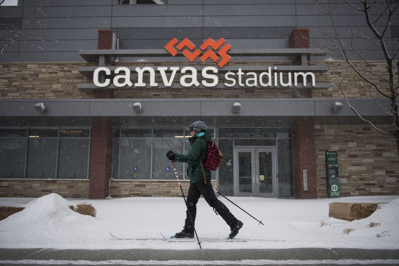 A cross country skier travels in the snow on Wednesday, March 13, 2019, in Fort Collins, Colo. A winter storm hit the western U. (Timothy Hurst/The Coloradoan via AP)
