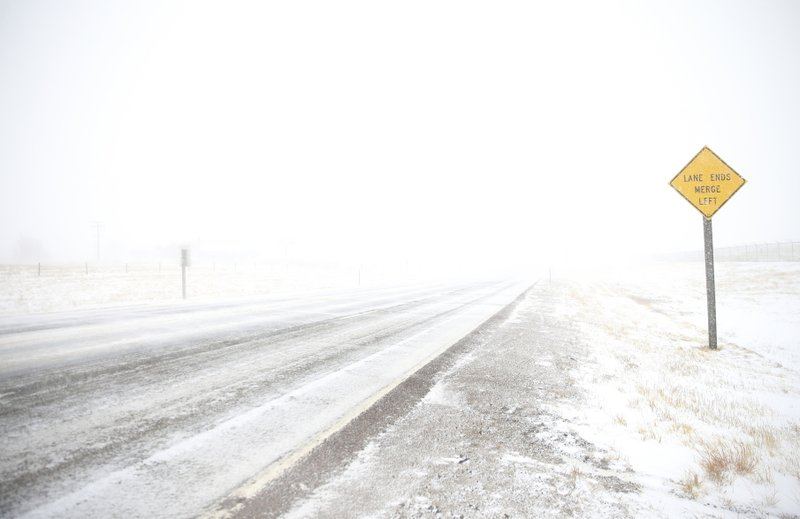 White-out conditions along Happy Jack Road during a blizzard on Wednesday, March 13, 2019, in Cheyenne. (Jacob Byk/The Wyoming Tribune Eagle via AP)