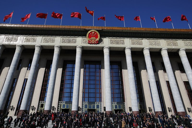 Delegates leave the Great Hall of the People after attending the closing session of China's National People's Congress (NPC) in Beijing, Friday, March 15, 2019. (AP Photo/Andy Wong)