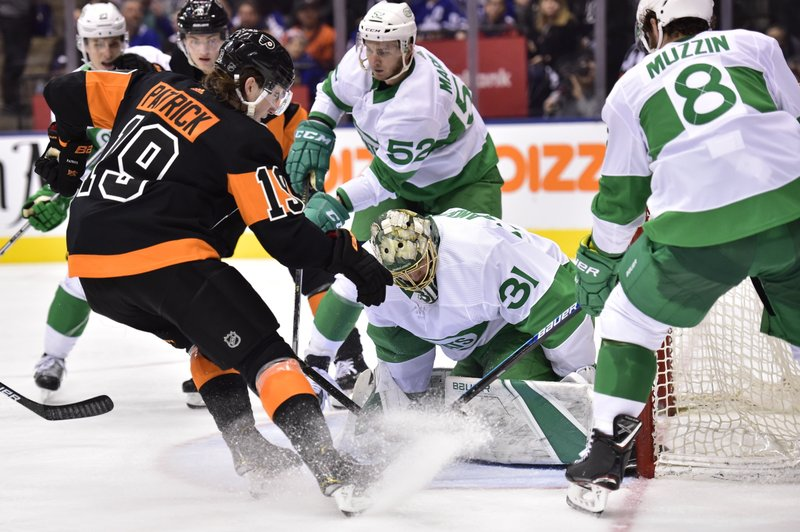 Toronto Maple Leafs goaltender Frederik Andersen (31) tries to cover the puck as Philadelphia Flyers centre Nolan Patrick (19) looks for a rebound during the third period of an NHL hockey game Friday, March 15, 2019, in Toronto. (Frank Gunn/The Canadian Press via AP)