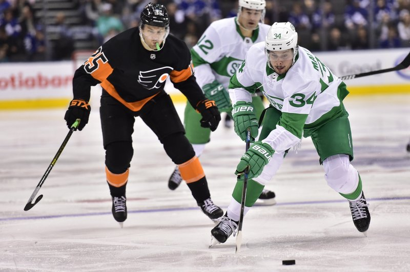 Toronto Maple Leafs center Auston Matthews (34) carries the puck up ice against the Philadelphia Flyers during the second period of an NHL hockey game Friday, March 15, 2019, in Toronto. (Frank Gunn/The Canadian Press via AP)n
