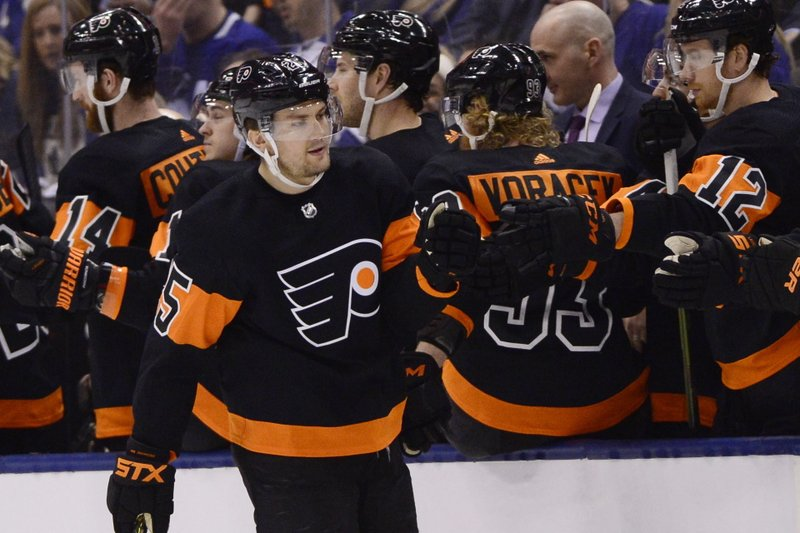 Philadelphia Flyers left wing James van Riemsdyk (25) is congratulated for his second-period goal against the Toronto Maple Leafs in an NHL hockey game Friday, March 15, 2019, in Toronto. (Frank Gunn/The Canadian Press via AP)