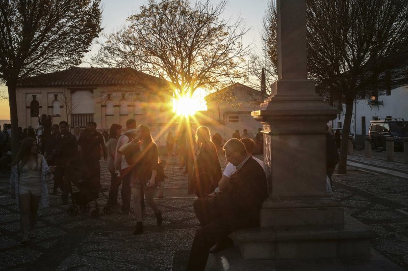 People gather at the historic Albaicin district in Granada, Spain, during sunset on Tuesday, March 12, 2019. (AP Photo/Mosa