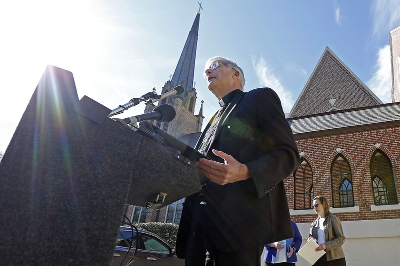 Bishop Joseph Kopacz speaks about the Diocese of Jackson releasing names of clergy members it says have been credibly accused of sexual abuse on its website, during a news conference in the parking lot of The Cathedral of St. (AP Photo/Rogelio V. Solis)