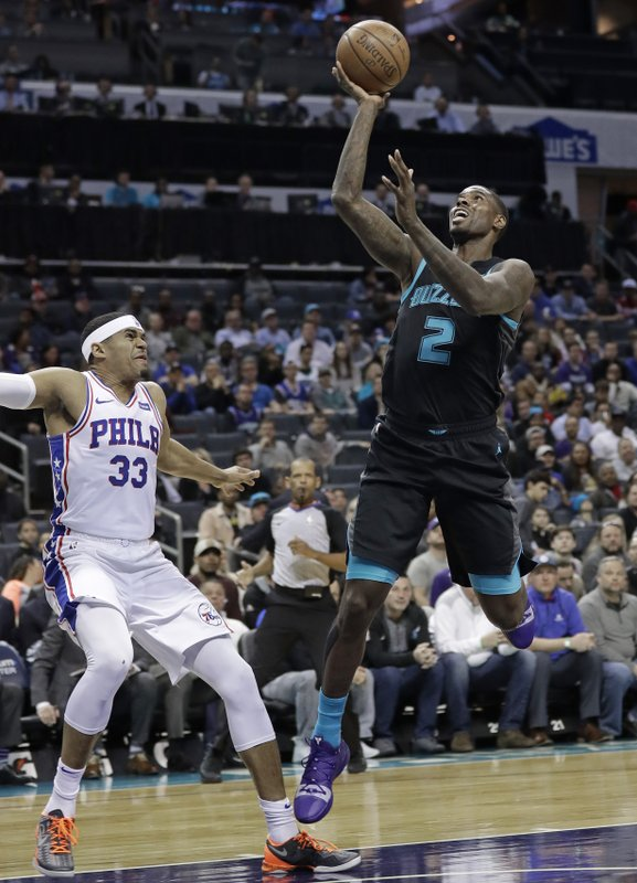 Charlotte Hornets' Marvin Williams (2) shoots against Philadelphia 76ers' Tobias Harris (33) during the first half of an NBA basketball game in Charlotte, N. (AP Photo/Chuck Burton)