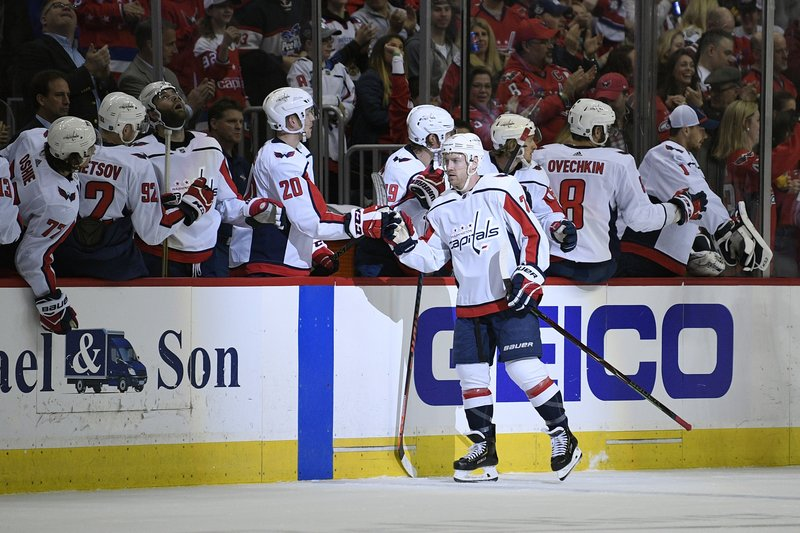 Washington Capitals center Travis Boyd (72) celebrates his goal with the bench during the second period of an NHL hockey game against the Philadelphia Flyers, Sunday, March 24, 2019, in Washington. (AP Photo/Nick Wass)