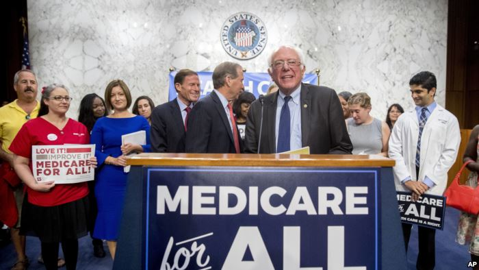 FILE - Sen. Bernie Sanders, I-Vt., is joined by Democratic Senators and suppo