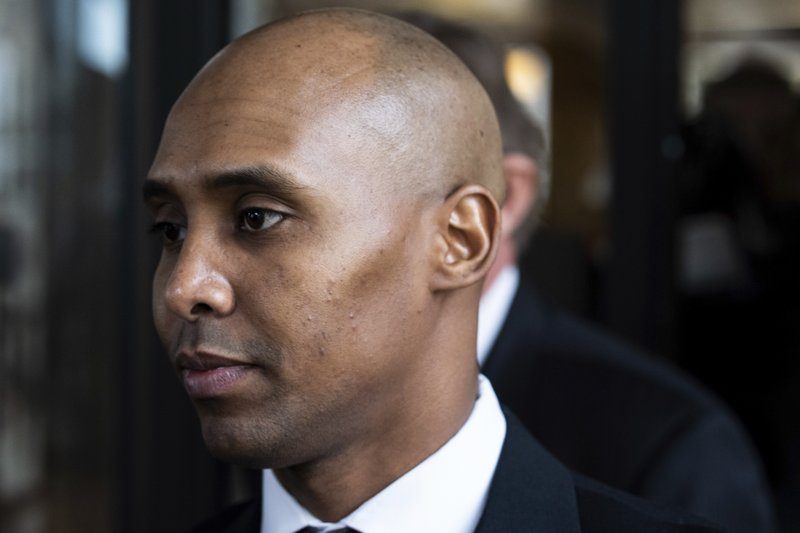 Former Minneapolis police officer Mohamed Noor leaves the Hennepin County Government Center after the first day of trial in Minneapolis on Monday, April 1, 2019. (Evan Frost/Minnesota Public Radio via AP)