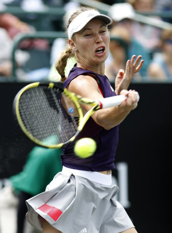 Caroline Wozniacki, from Denmark, returns a shot to Petra Martic, from Croatia, during their semifinal match at the Volvo Car Open tennis tournament in Charleston, S. (AP Photo/Mic Smith)