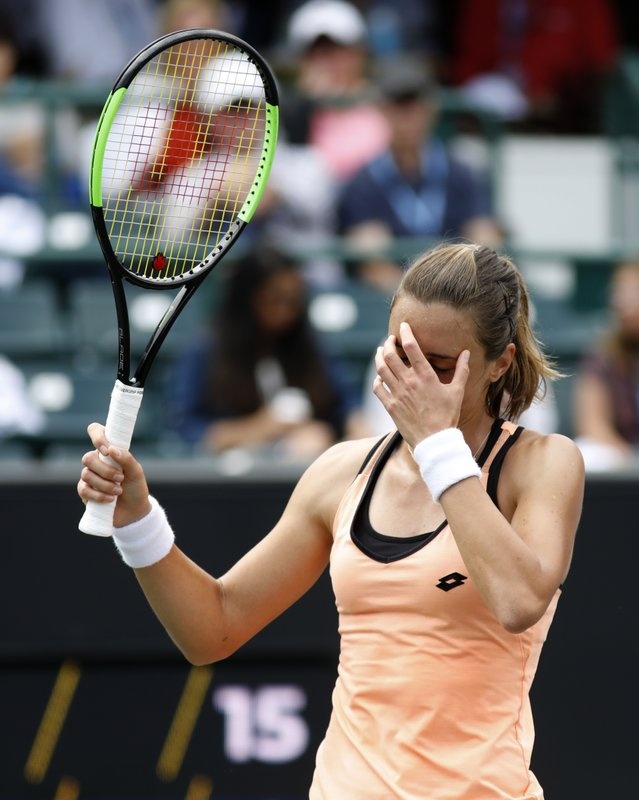 Petra Martic, from Croatia, reacts to a bad shot against Caroline Wozniacki, from Denmark, during their semifinal match at the Volvo Car Open tennis tournament in Charleston, S. (AP Photo/Mic Smith)