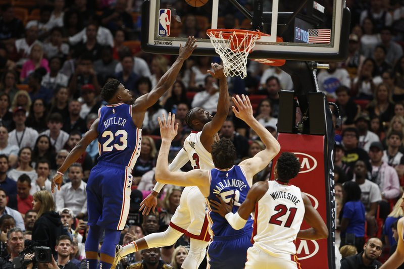 Miami Heat guard Dwyane Wade (3) shoots the ball in the first half of an NBA basketball game against Philadelphia 76ers guard Jimmy Butler (23) on Tuesday, April 9, 2019, in Miami. (AP Photo/Brynn Anderson)